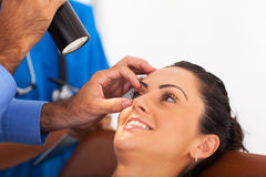 Woman eye checkup Stock Image