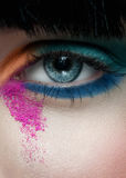Woman eye with colorful make-up Stock Images
