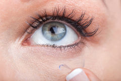 Woman eye with contact lens applying Royalty Free Stock Photo
