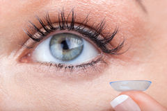 Woman eye with contact lens applying Royalty Free Stock Photos
