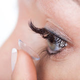 Woman eye with contact lens applying. Macro royalty free stock photos