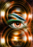Woman eye and cosmic space, with light circle. Stock Photo