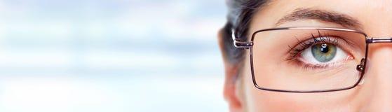 Woman eye with eyeglasses. Royalty Free Stock Image