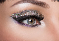 Woman eye with fashion makeup Stock Images