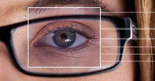woman with eye focus box detail over glasses and lines royalty free stock image