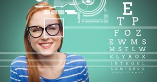Woman with eye focus box detail over glasses and Eye test interface. Digital composite of Woman with eye focus box detail over glasses and Eye test interface royalty free stock image