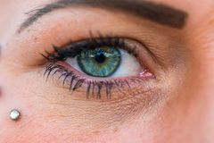 Woman eye in green and blue color stock photo