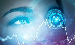 Woman eye in HUD with graphs. Close up of blonde woman face with HUD around eye and graph over gray background. Concept of face recognition stock photography