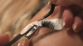 Woman Eye with Long Eyelashes. Eyelash Extension. Lashes, close up, selected focus. stock video