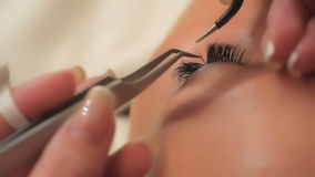 Woman Eye with Long Eyelashes. Eyelash Extension. Lashes, close up, selected focus. stock footage
