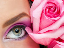 Woman eye with makeup and rose royalty free stock photo