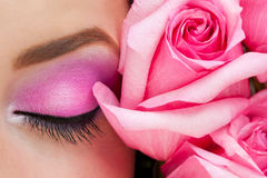 Woman eye with makeup and rose royalty free stock image