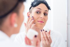 Woman removing her makeup before sleeping Royalty Free Stock Images