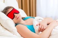 Woman with eye mask sleeping Stock Photos