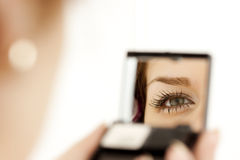 Woman eye in the mirror Royalty Free Stock Photos