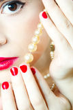 Woman Eye and pearls. Woman eye, red lips and pearls Stock Images