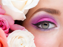 Woman eye and roses stock photos