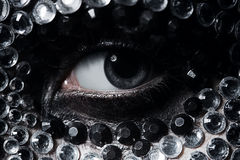 Woman eye with silver and black rhinestones. On face Stock Images