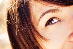 Woman eye staring up Stock Image