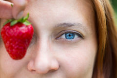 Woman eye with strawberry Royalty Free Stock Photos