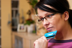 Woman in eyeglasses with card Royalty Free Stock Image