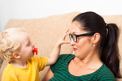 Woman in eyeglasses and child Stock Photo