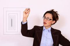 Woman with eyeglasses drawing a diagram Royalty Free Stock Photos