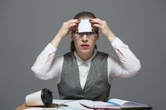 A woman sticks a sticker to her forehead stock photos