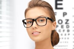 Woman in eyeglasses with eye chart Stock Photos