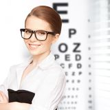 Woman in eyeglasses with eye chart Royalty Free Stock Photo