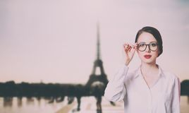 Woman with eyeglasses at Parisian Eiffel tower background Stock Photography
