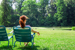Woman in eyeglasses relax on greenfield. royalty free stock photos