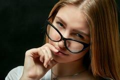 Woman in eyeglasses Stock Photos