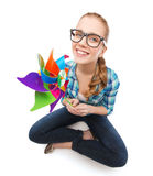 Woman in eyeglasses sitting on floor with windmill Stock Images