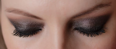 Woman eyes. With long eyelashes and makeup Stock Images