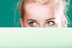 Woman eyes behind white sign Stock Photography