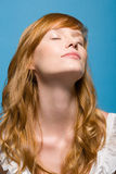 Woman with eyes closed stock images