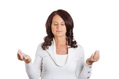 Woman with eyes closed hands raised in air meditating. Portrait woman with eyes closed hands raised in air meditating Royalty Free Stock Image