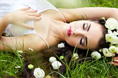 Woman with eyes closed lying on blooming meadow Royalty Free Stock Photography