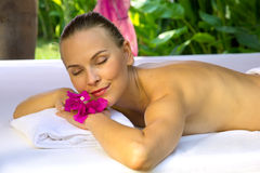 Woman with eyes closed, lying on a spa bed. Royalty Free Stock Image