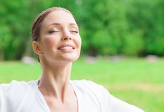 Woman with eyes closed. Portrait of woman with eyes closed. Concept of healthy lifestyle and relaxation Royalty Free Stock Image