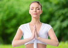 Woman with eyes closed prayer gesturing Royalty Free Stock Photo