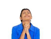 Woman eyes closed praying hoping for the best Stock Photography