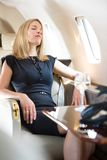 Woman With Eyes Closed Relaxing In Private Jet stock images