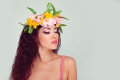 Woman with eyes closed showing colorful makeup. Closeup portrait of woman with eyes closed showing colorful makeup in floral crown on head. Colombian latina stock images