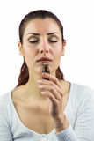 Woman with eyes closed and smelling bottle of medicine Royalty Free Stock Images