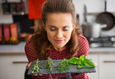 Woman with eyes closed smelling fresh herbs Royalty Free Stock Image