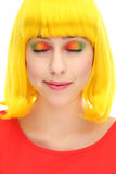 Woman with eyes closed wearing colorful eyeshadow. Woman wearing wig over white background Stock Photo
