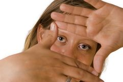 Woman eyes framed by hands Stock Image