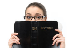 Woman eyes and hands holding bible. Stock Photos